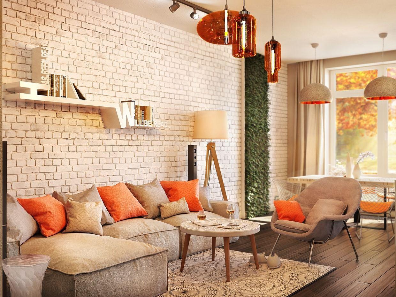 серый диван с оранжевыми подушками